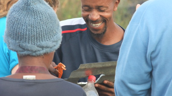 A community member in Innesfree, Johannesburg assembles a 'Litre of Light' bottle