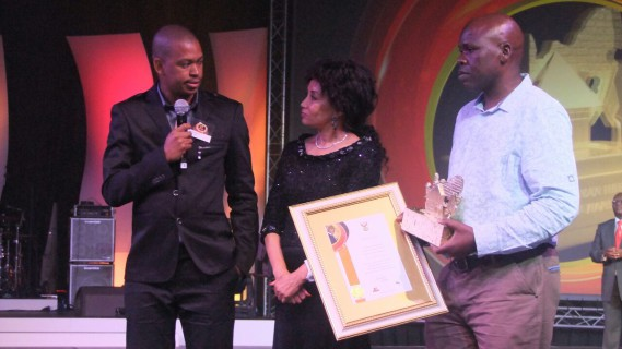 Patrick's son, Charles Hunsley, receives the Lifetime Achievement Award on behalf of his father from Minister of Human Settlements, Lindiwe Sisulu