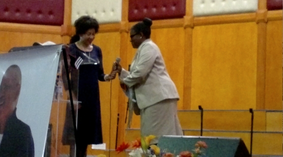 Lindiwe Sisulu, Minister of Human Settlements and Rose Molokoane, National Coordinator of FEDUP at Patrick Hunsley's funeral on 16 August 2014.
