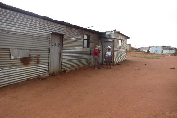 Philda and Cynthia outside FEDUP office in Tinasonke