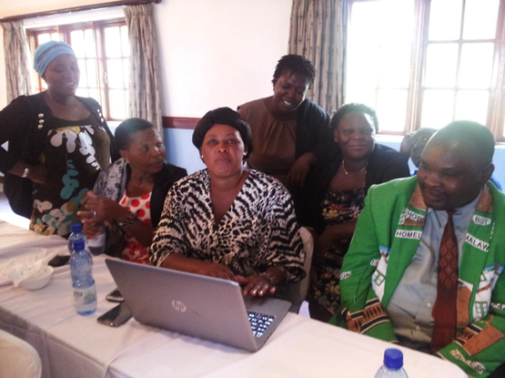 Malawi Federation members work with the online data platform.