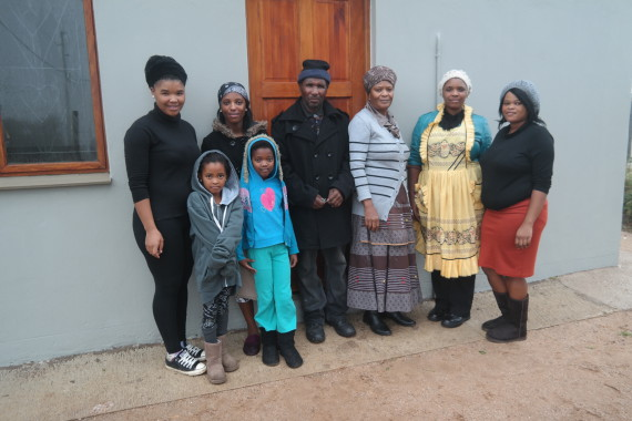 FEDUP member, Norman Bles, with his family infront of the newly finished house.