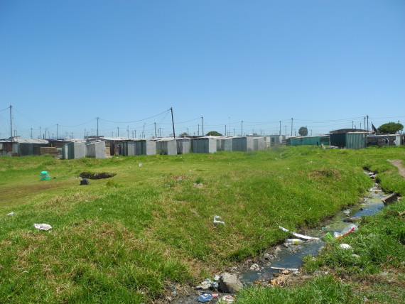 Poor drainage and municipal toilets on border of Wetland