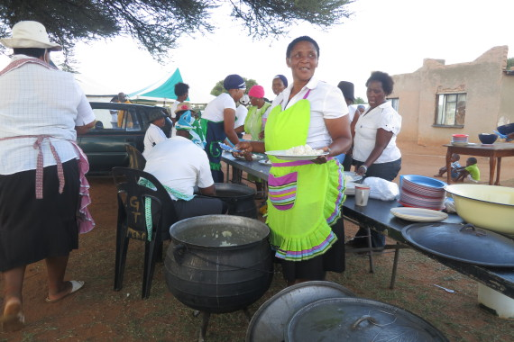 Using their own savings, Mafikeng group members prepare a meal for all members at the Network meeting