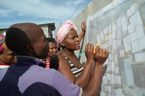 Community of Tambo square doing house designs with technical team