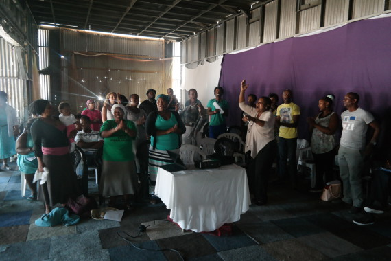 Alliance begins Cape Town partnership meeting in song in Bosasa Community Hall, Mfuleni