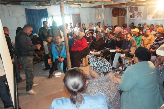 Nkokheli facilitates a community gathering with informal settlement leaders in Khayelitsha's Site B
